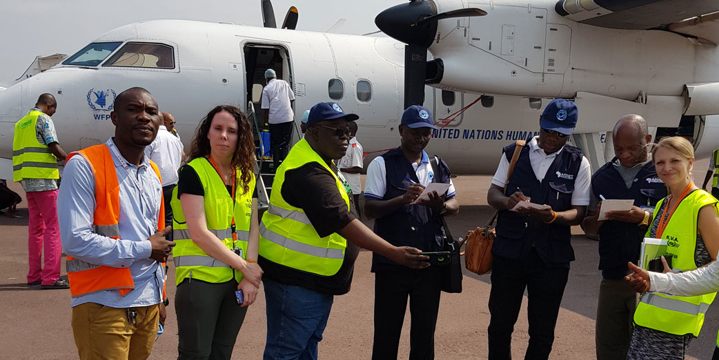 ACoDD team on arrival from Mbandaka, met with CDC staff filling out Ebola Screening forms on arrival at Kinshasa airport, DRC