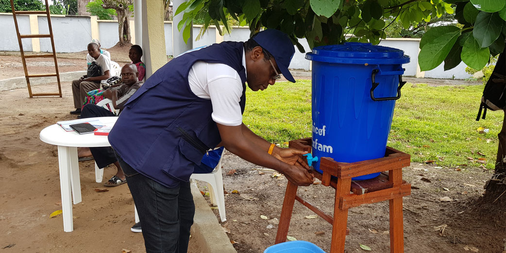 Dr Chima Ohuabunwo –AFENET Executive Director washing his hands on arrival at the Ebola Coordination Center, Mbandaka, DRC