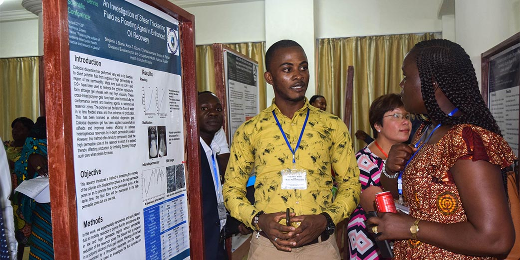 Liberia FETP resident making a poster presentation at the first annual scientific conference