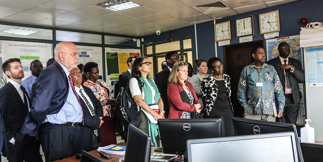 US CDC and MOH delegation visit to Public Health Emergency Operations Center (PHEOC). Presentation was made by Mr Simon Kyazze - – Operations and GIS Specialist, PHEOC