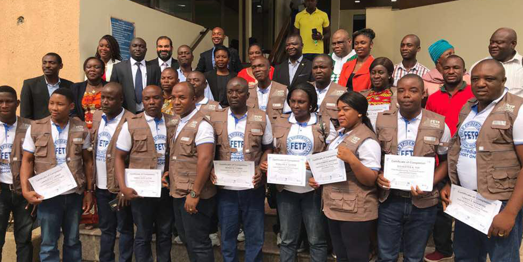 Graduates of the 1st intermediate FETP in Liberia and Dignitaries at the graduation ceremony in Monrovia